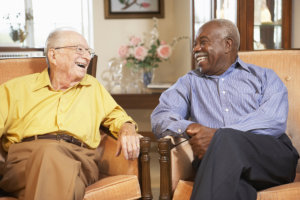 two old man happily talking to each other